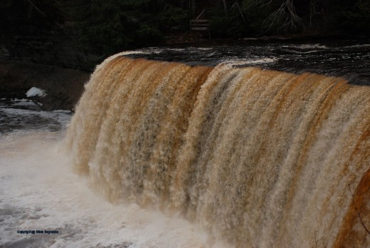 The Upper Tahquamenon Falls is running full with spring high water season.