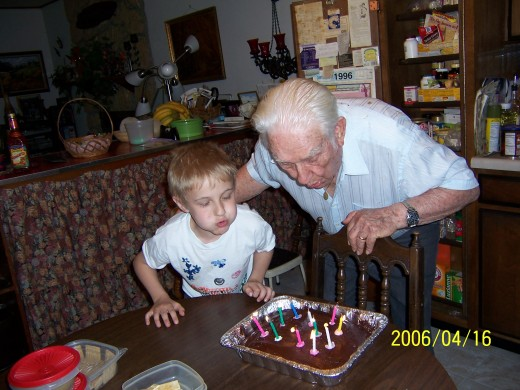 Blowing out birthday candles a few years ago