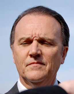 Why is Richard Scrushy frowning?