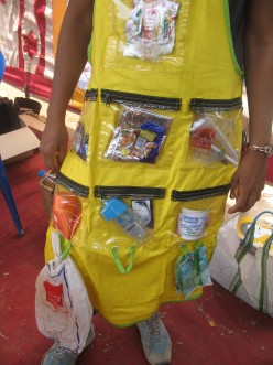 YOU  WEAR  THIS  APRON  IN  YOUR  KITCHEN  WHEN  SORTING  OUT  THE  WASTE  AND  KEEP  THE  PLASTIC  WASTE  FOR  GIVING  IT  TO  RECYCLING  IT.