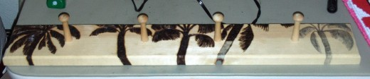 Here four of the five palm trees have been wood burned on the rack.