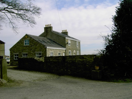 A recently renovated farm house is located at the side of the lane. D.A.L.