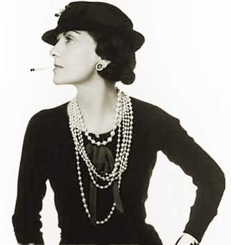 Coco Chanel in her famous black knit jumper