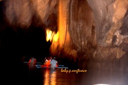 Stalactites and stalagmites abound around the underground river