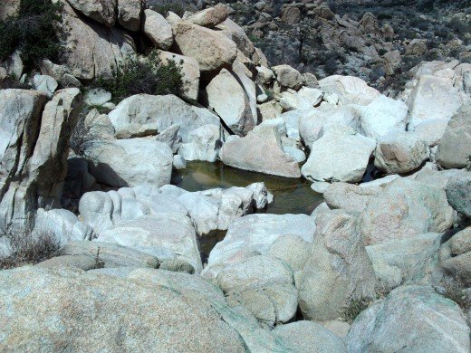 Water trickling through the rocks.