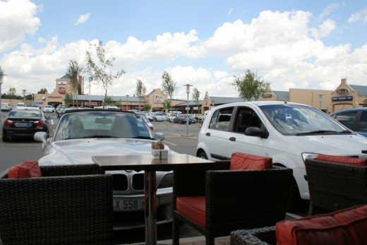 Typical mall with coffee bars overlooking parking grounds