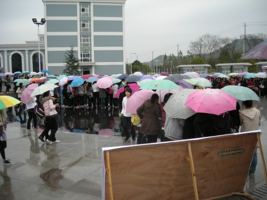 Students having a festival in the rain.