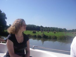 Gisela admires the Burgundy scenery from our boat.