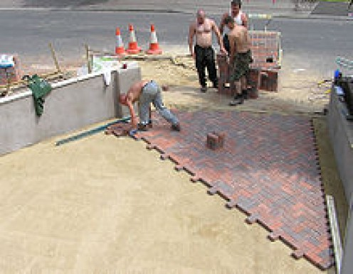 This Brick Paver Patio Is Being Laid Over A Sand Base.
