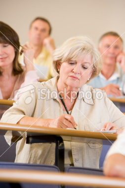 Student takes notes during lecture