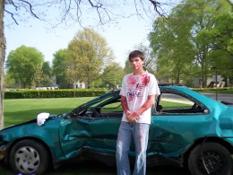 My son Danny standing next to the car used in the simulation.