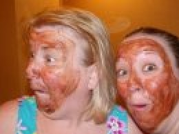 The author, being goofy with her daughter, donning chocolate face masks.....living in authenticity.