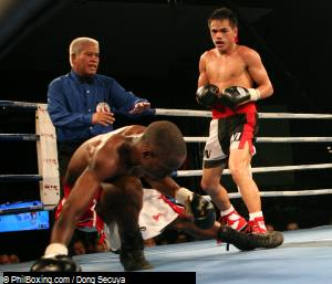 "Taking up the opening fight, Larry  ""Boy""  Canillas let go powerful right crosses and uppercuts, knocking out Fred Sayuni of Tanzania in the 6th round"