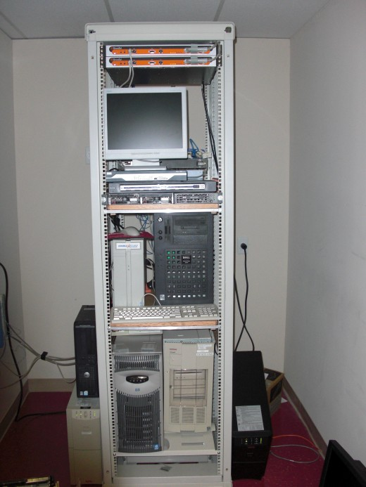 Server Rack Containing Servers, Monitors, and Telecommunications Equipment