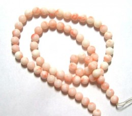 Pink and white coral bead. These are also angel skin coral, but the color is darker and a little more splotchy than the ones on the left. This coral is all natural and has not been dyed.