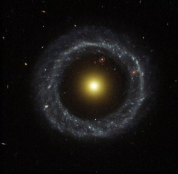 Ring of Hot Blue Stars Pinwheels Around Yellow Nucleus of Hoag's Object Galaxy