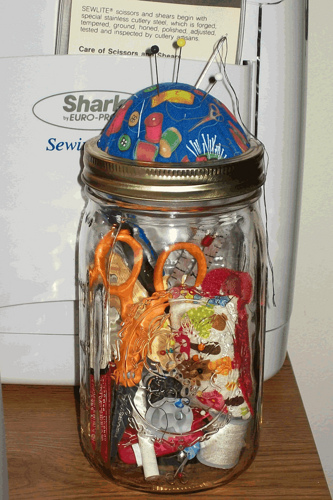 I found a picture of a canning jar turned into a sewing kit on Flickr.