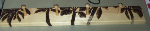 In this digital image I have burned the top of all five of the palm trees, but only the first three are completely finished.  See how I like to go back and forth when I am using the pyrographic stylus?  I do this because wood burning can be smelly, a