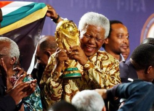 Nelson Mandela with the World Cup as South Africa are the host nation of the 2010 World Cup