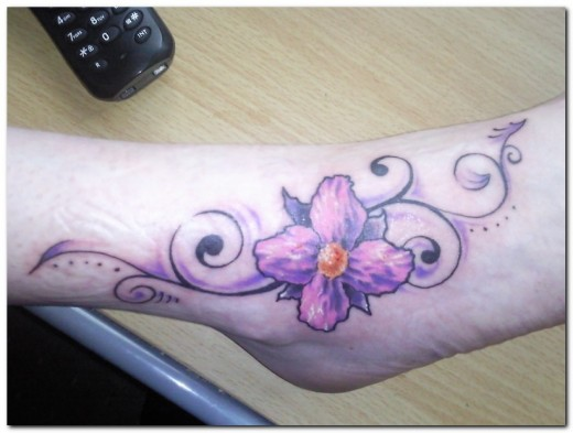 well enjoy this lovely lil purple Orchid flower tattoo.