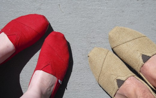 Women's TOMS shoes in red (my feet), Men's TOMS shoes in burlap (right)