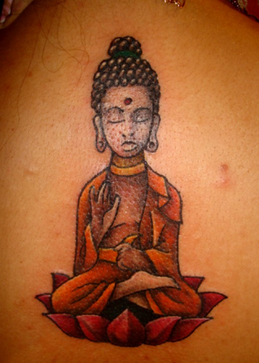 Another lil buddha tattoo on the upper back and I likes the artwork in this
