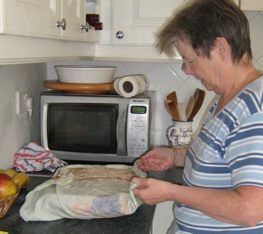 Cover the Soda Bread with a damp clean cloth