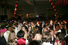 A crowded dance-floor at a prom
