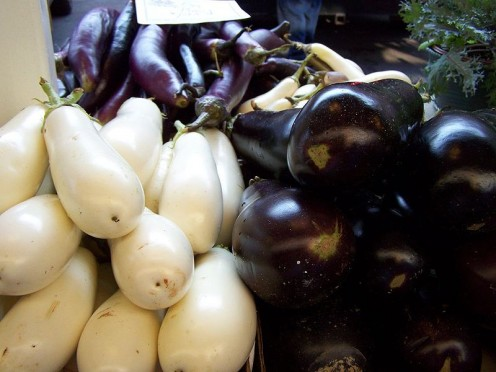The small egg shaped white skinned vegetables clearly indicate the source of the name eggplant. The purple skinned version is more popular and there are also some varieties with streaked purple white skins.
