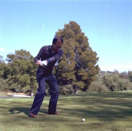 Keep your head down to maintain alignment during your swing.