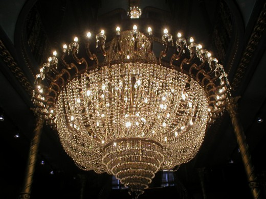 Get the touch of the chandelier with mini chandeliers.