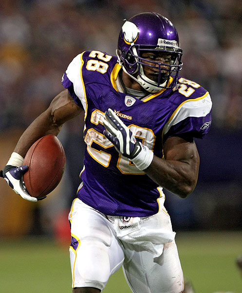 "Minnesota Vikings Running Back Adrian ""All Day"" Peterson taking it to the house! photo NFL.com"