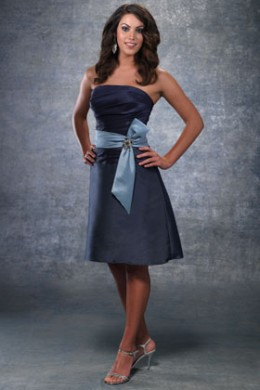 Bridesmaid Dress: Venus Bella Bridesmaids Dress 943606 Short strapless dress of silky taffeta with a shirred bodice and short skirt. Wide band and bow at waist.