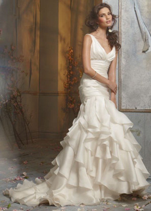 Jim Hjelm Bridal Gowns, Wedding Dresses: Style jh8000 Ivory Silk Satin Faced Organza formal bridal gown, empire V neckline accented with crystal trim, draped elongated bodice, bias cut asymmetrical ruffle skirt, chapel train.