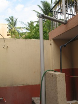 HERE THE PIPE LETS THE WATER IN TO A OPEN WELL COVERED WITH A GRILL.