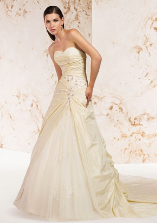 Alyce Designs Claudine Wedding Dress: Calista - 7226 Taffeta Tulle   Strapless gown with sweetheart neckline; banded, wrapped bodice with beading; split Polonaise overskirt with train; tulle underskirt.