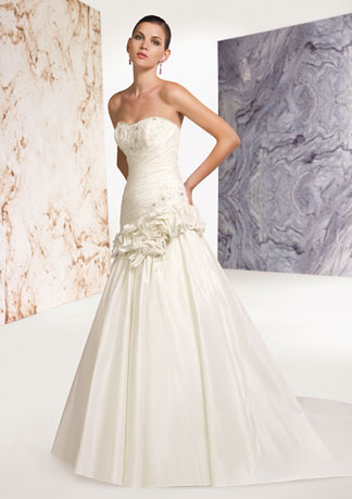 Alyce Designs Claudine Wedding Dress: Cara - 7231 Taffeta    Strapless gown with sweetheart neckline; asymmetrically ruched bodice; back lace-up corset styling; floral hip detail, full skirt with cascading back ruffle and train