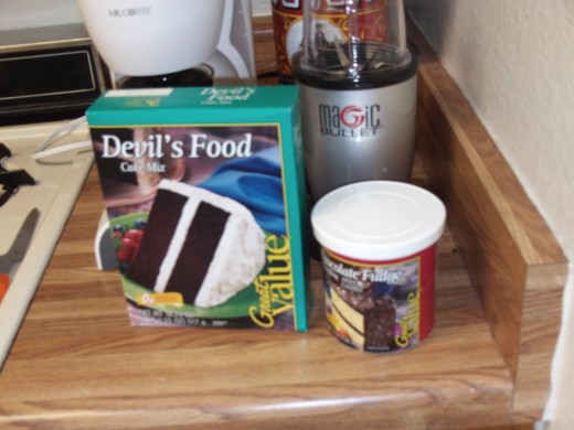 Here I am using my cheap $0.87 cent cake mix and $1.12 frosting mix that I bought at Walmart.  In my humble opinion these cheaper brands taste just as good as the more expensive name brands, but you use whatever you like as it is your cake.