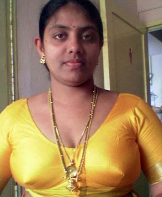 yellow blouse photos of a kerala nonactress looking very beautiful