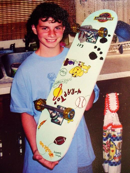 Kelsey with a custom designed skate board-(upside down??-LOL