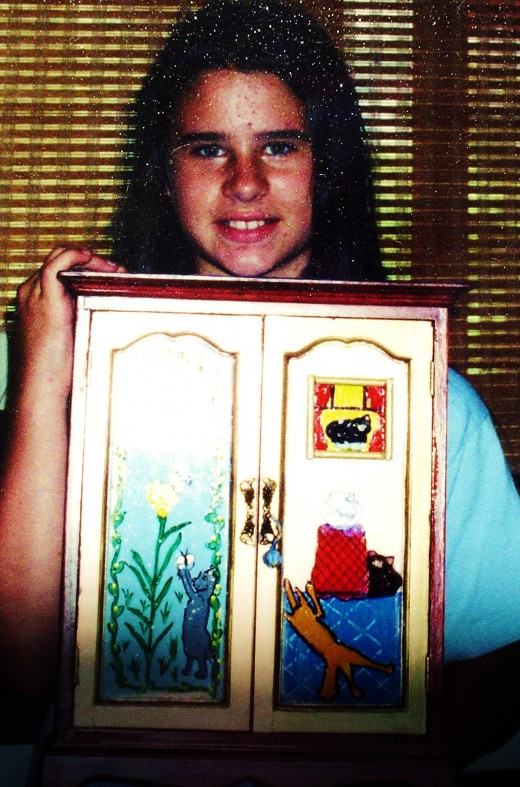 A student with a handpainted jewelry cabinet