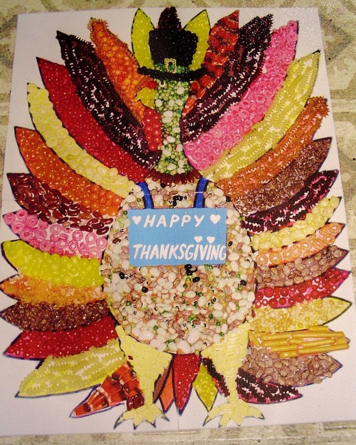 A Thanksgiving decoration made out of beans and seeds