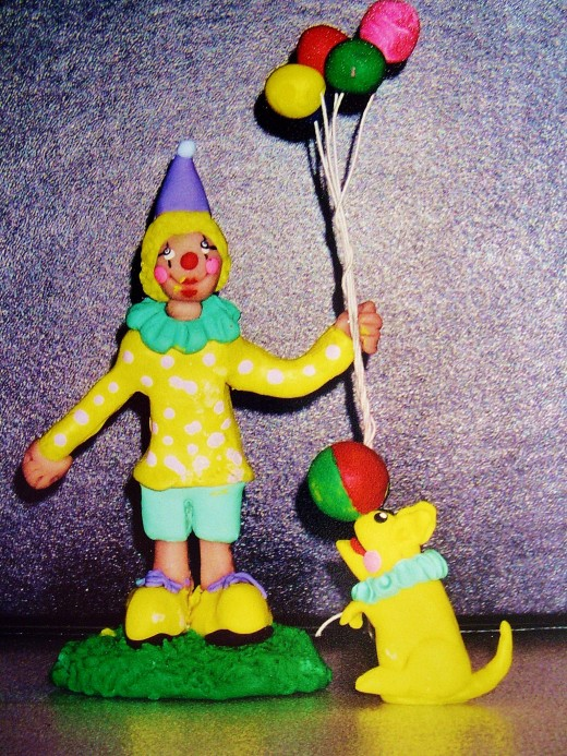 A first grader's sculpture of a clown and his dog