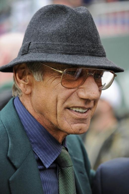 Former New York Jets quarterback Joe Namath looks on before the Jets play the Miami Dolphins at Giants Stadium in East Rutherford, N.J., Sunday, Nov. 1, 2009. (AP Photo/Bill Kostroun)