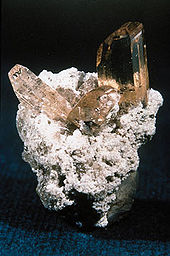 A Group of Topaz Crystals on Matrix. Photo Courtesy of wikipedia