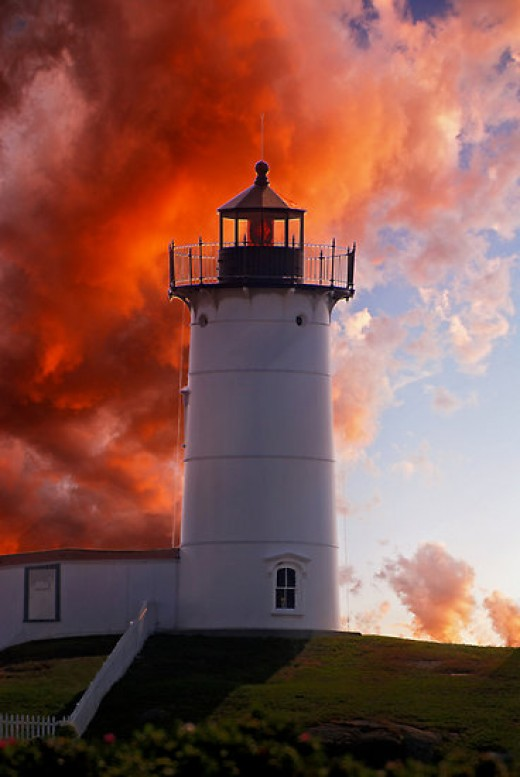 This red sky near a lighthouse can be a presage of a storm from the sea, especially on the east coast.