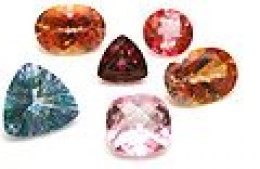 A collection of topaz gemstones. Mystic topaz is far left.