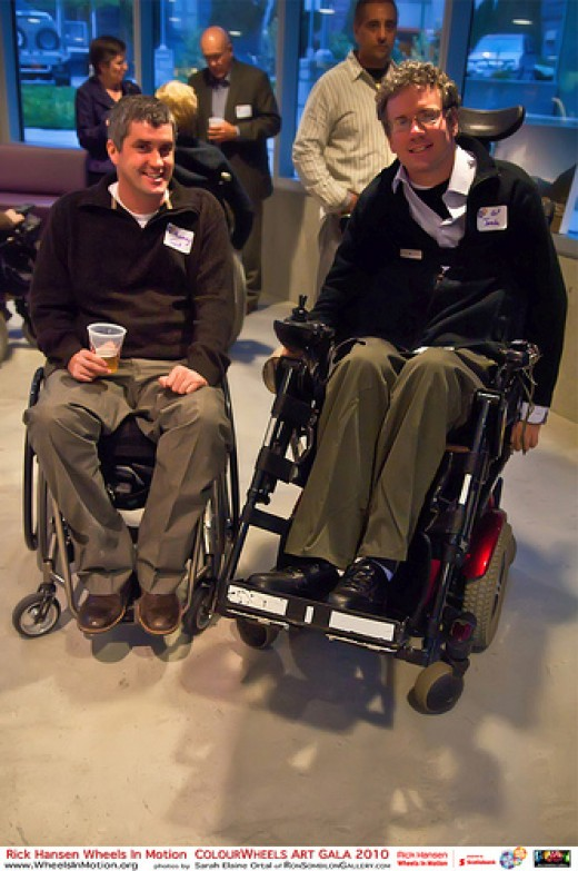 Men in manual wheelchair and power chair