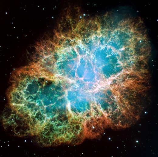 This is a Hubble Telescope image of the whole Crab Nebula with enhanced colors showing different elements blown off in the supernova explosion that left a neutron star core.