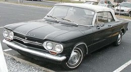 "The ""Early Model"" Corvair. Leaking oil is implied."